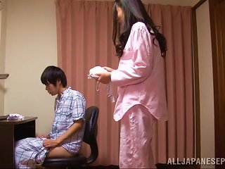 A Sweet Japanese Housewife Gives Her Man A Handjob