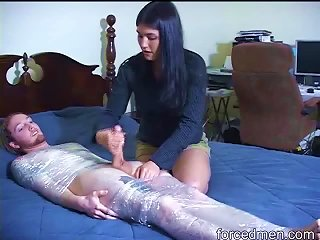 Dude In Plastic Wrap Stroked By Clothed Girl